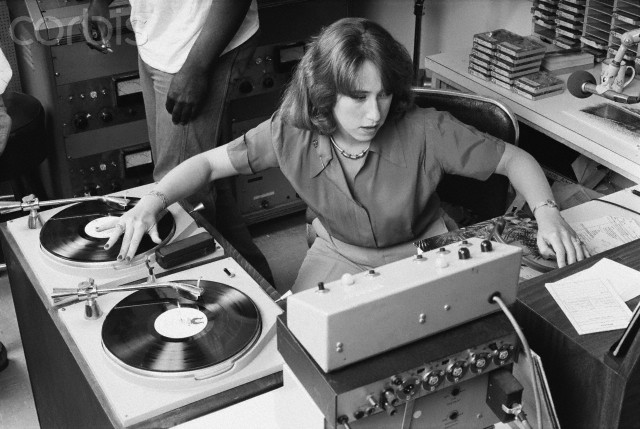 13 Jul 1978 --- KRE radio disc jockey Joanne Rosenweig spins a record on her broadcast. --- Image by © Roger Ressmeyer/CORBIS